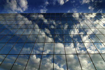 Glass Building for Business Reflection of Blue Sky and Clouds