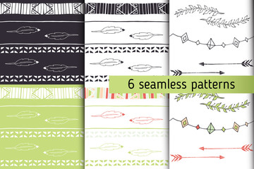 Ethnic seamless patterns collection with arrows, feathers, garlands, laurel. Tribal vector patterns for design. Boho patterns set