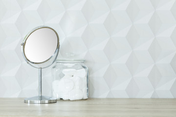 Round mirror and cotton jar
