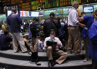Traders work in the silver and gold options pit on the floor of the New York Mercantile Exchange in New York in New York