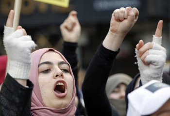 Syrian women living in Turkey shout slogans during a demonstration against Syria's President Bashar Al-Assad in front of the Syrian Consulate in Istanbul