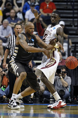 St Bonaventure's Zach Moore has the ball stripped away by Florida State's Okaro White during the second half of their men's NCAA basketball game in Nashville