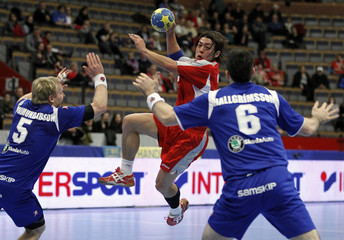 Japan's Miyazaki attempts to score between Iceland's Ingimundarson and Hallgrimsson during their group B match at the Men's Handball World Championship in Linkoping