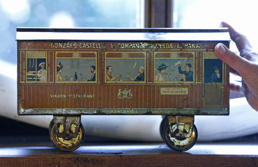 Dardenne shows a lithographed tin box, that is made in Spain and designed in the shape of a wagon and contained biscuits, displayed at her house in Grand-Hallet