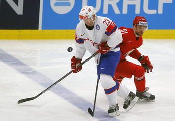 Norway's Trygg fights for the puck with Gavrus of Belarus during their Ice Hockey World Championship game at the CEZ arena in Ostrava