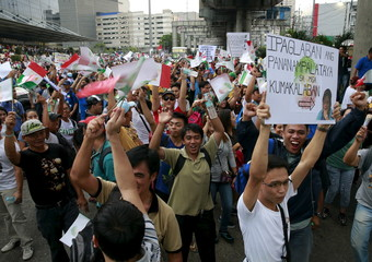 Protesters belonging to the Iglesia ni Cristo (Church of Christ) group march along EDSA highway in Mandaluyong