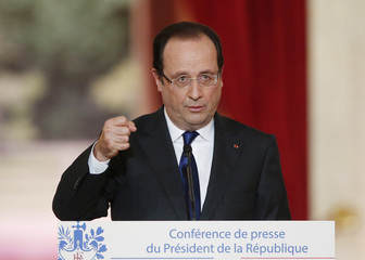 French President Hollande replies to questions after his speech at the Elysee Palace in Paris
