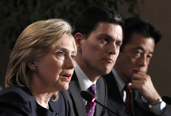 U.S. Secretary of State Clinton speaks during the closing news conference with Britain's Foreign Secretary Miliband and Japan's Foreign Minister Okada at the G8 foreign ministers' meeting in Gatineau