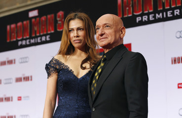 "Cast member Ben Kingsley and his wife Daniela pose at the premiere of ""Iron Man 3"" at El Capitan theatre in Hollywood"