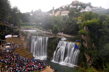 A competitor takes part in the third international waterfall jumping competition held in the old town of Jajce