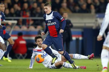 Paris St Germain's Verratti challenges Olympique Lyon's Grenier during their French Ligue 1 soccer match in Paris