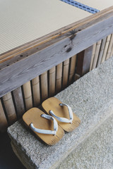Geta or traditional Japanese footwear, a kind of flip-flops or sandal with an elevated wooden base held onto the foot with a fabric thong strap