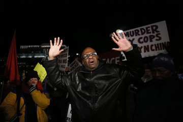 Protester holds up his hands in downtown Denver