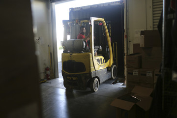 Chris Romero of Stop Hunger Now uses a forklift to load food and medical supplies onto a truck bound for victims of Typhoon Haiyan in the Phillipines, in San Leandro