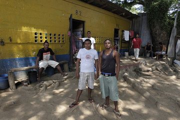 Inmates pose for a picture at the jail where crew members of Florida-based shipwreck salvage company Aqua Quest International have been detained, in Puerto Lempira