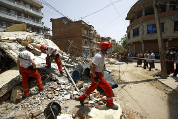 Members of the joint Swiss and French rescue teams search for victims following Saturday's earthquake in Kathmandu