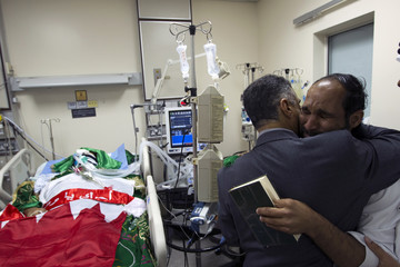 Relatives grieve after being told by doctors that Ridha Mohammed, shot in the head during protests on Friday, is brain dead at Salmaniya  hospital  in Manama
