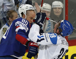 France's Da Costa fights with Finland's Hietanen during their 2013 IIHF Ice Hockey World Championship preliminary round match at the Hartwall Arena in Helsinki