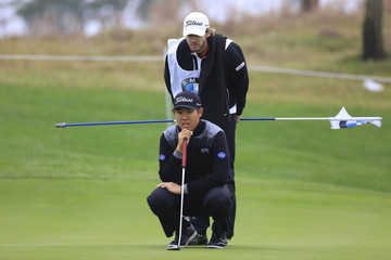 Byeong-hun An of South Korea considers a shot on the third hole during the second round of the BMW Masters 2015 golf tournament at Lake Malaren Golf Club in Shanghai