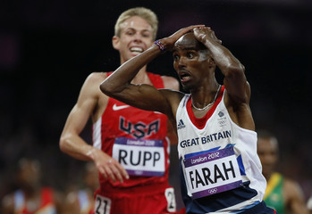 Britain's Mo Farah reacts to winning the men's 10,000m final during the London 2012 Olympic Games at the Olympic Stadium