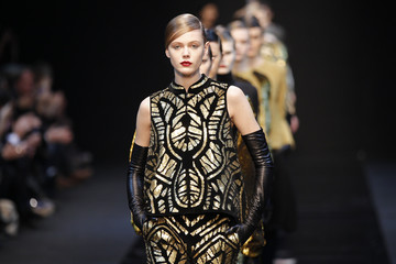Models present creations by French-Swedish designer Marcel Marongiu as part of his Fall/Winter 2012-2013 women's ready-to-wear collection for French fashion house Guy Laroche during Paris fashion week