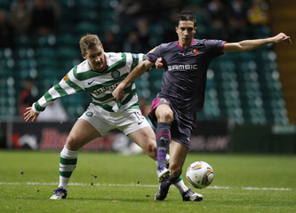 Stade Rennes' Pajot holds off Celtic's Commons during their Europa League Group I soccer match in Glasgow, Scotland
