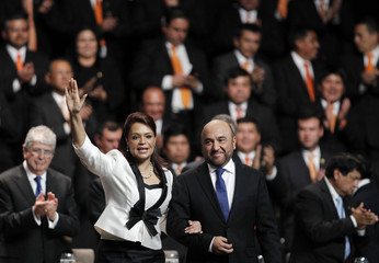 Baldetti celebrates next to her husband after receiving appointment as new vice-president in Guatemala City
