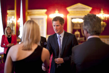 Britain's Prince Harry meets guests  before introducing the final lecture in a series by South African Historian and lecturer Rob Caskie at St James's Palace in London