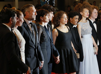 """Director Maiwenn and cast members pose on the red carpet as they arrive for the screening of the film """"Mon roi"""" in competition at the 68th Cannes Film Festival in Cannes"""