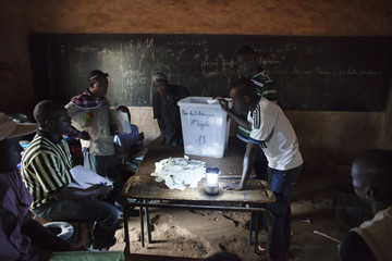Poll workers count ballots in Bamako