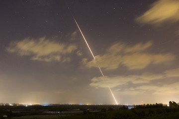 A streak of light is seen as a rocket is launched from the northern Gaza Strip towards Israel