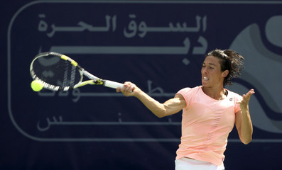 Schiavone of Italy hits a return to Kuznetsova of Russia during their match at the WTA Dubai Tennis Championships