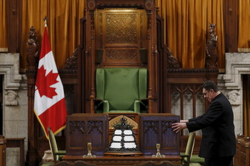 A staff member adjusts a ballot box in the House of Commons on Parliament Hill in Ottawa
