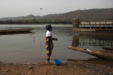 A woman cleans freshly caught fish on the shores of the Obangui river in the district of Wango of the capital Bangui