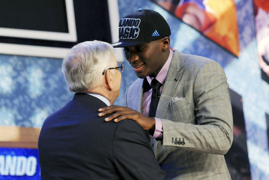 Oladipo from the UNLV greets NBA Commissioner Stern on stage after being selected by the Magic as the second overall pick in the 2013 NBA Draft in Brooklyn