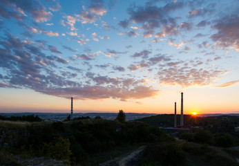 Sunset above the chimney, chemical industry