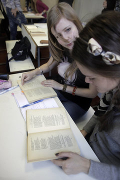 Russian-speaking students learn from textbooks during a Russian literature lesson in Riga