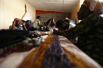 Women make different products using beads at the Uzima bead-making workshop in Nairobi