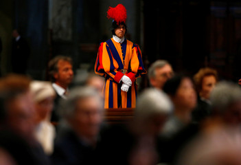 A Swiss guard stands guard during a funeral service for Italian Cardinal Giovanni Coppa in Saint Peter's Basilica at the Vatican