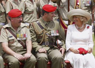 Britain's Camilla, Duchess of Cornwall, smiles with members of Royal Australian Corps of Military Police following ceremony appointing her as their Colonel-in-Chief at Victoria Barracks in Sydney