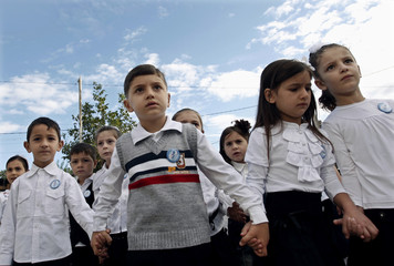 First graders walk to their classroom after a festive ceremony to mark the start of a new school year in Tbilisi