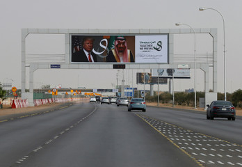U.S. President Donald Trump's and Saudi Arabia's King's Salman bin Abdulaziz Al Saud's photos are seen with flags of both countries on airport road as part of celebrations to welcome United States President Donald Trump, in Riyadh