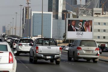 U.S. President Donald Trump's and Saudi Arabia's King's Salman bin Abdulaziz Al Saud's photos are seen on airport road as part of celebrations to welcome United States President Donald Trump, in Riyadh