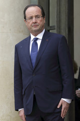 French President Francois Hollande waits for guests at the Elysee Palace in Paris