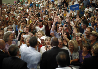 Supporters cheer for U.S. President Barack Obama during an election campaign rally in Grand Junction