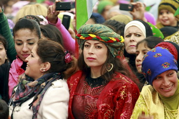 Kurds celebrate Newroz, which marks the arrival of spring and the new year, in Aleppo