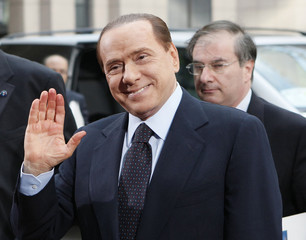 Italy's Prime Minister Berlusconi arrives at an European Union leaders summit in Brussels