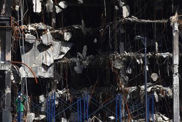 Labourer works at the damaged Central World shopping complex in central Bangkok