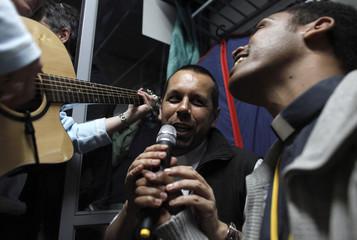 Italian priest Luca Bovio and Ethiopian priest Ashenafi Yonas Abebe sing a religious song with pilgrims to Rome