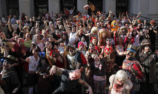 People dressed up as zombies pose for a picture in New York